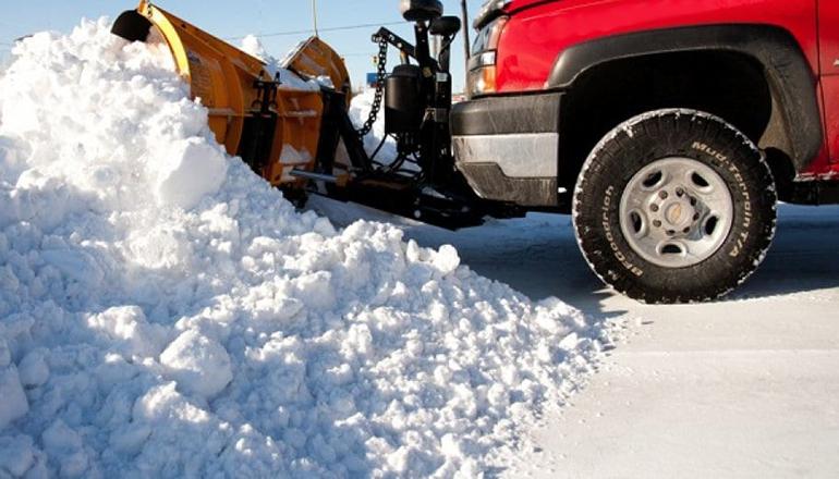 Pickup plowing snow