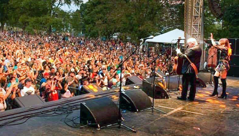John Pine surveys the crowd after performing at Roots-N-Blues Festival