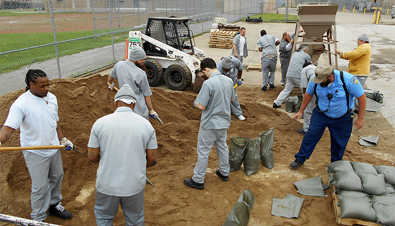 Offenders filling sand bags